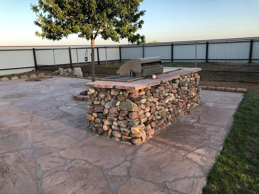 Sit Around the Custom Rock Outdoor Grill