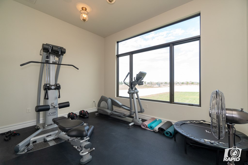 Workout Room off of His Master Bath